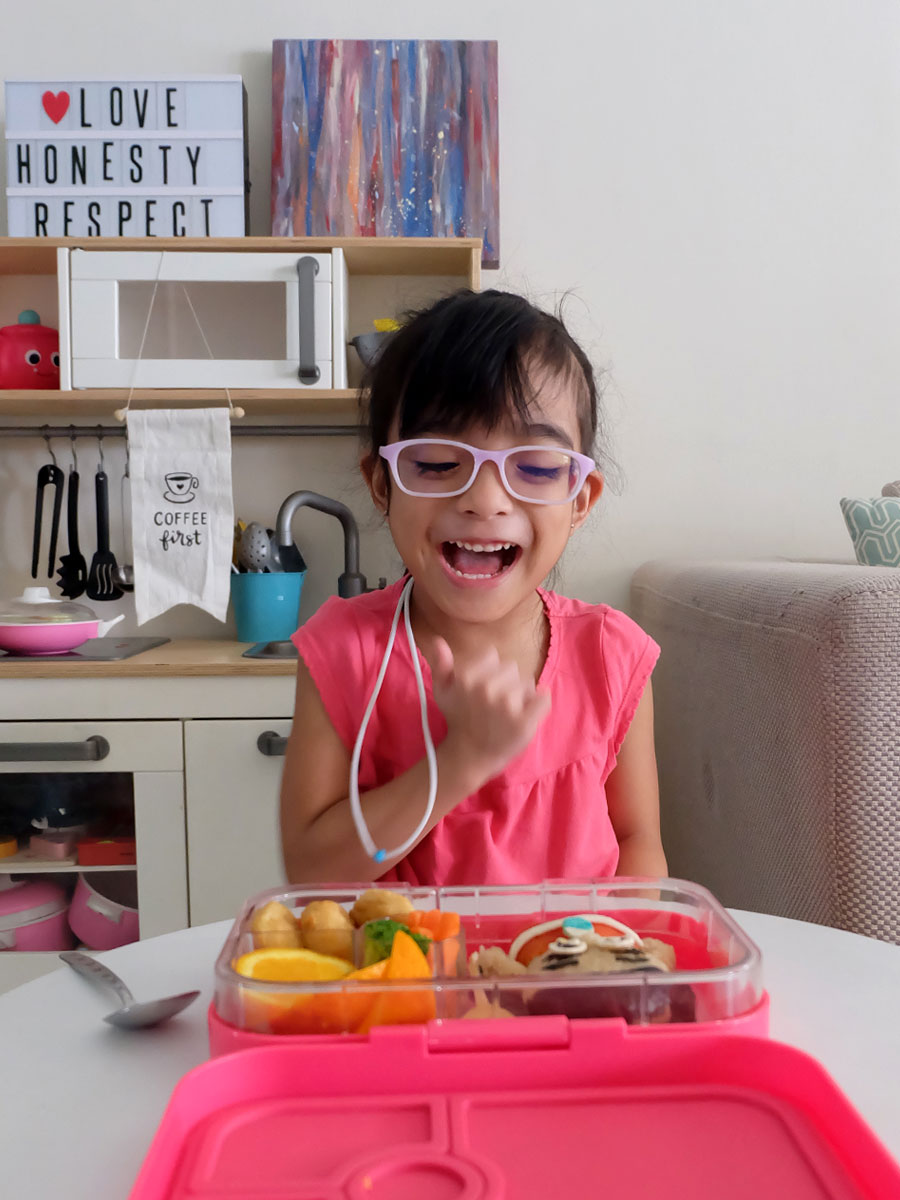Zoë enjoying her Moana Bento Food Art