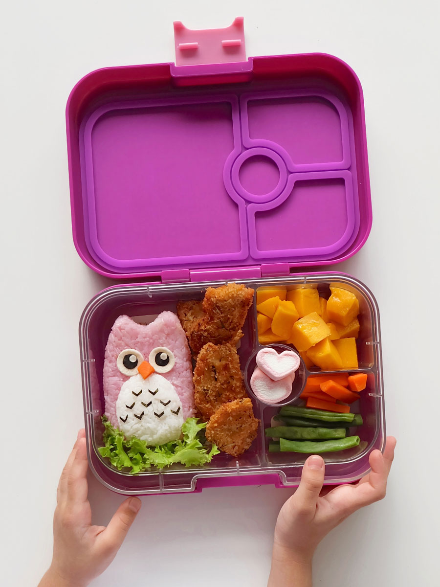 Owl bento food art inside a Yumbox Panino in Bijoux Purple