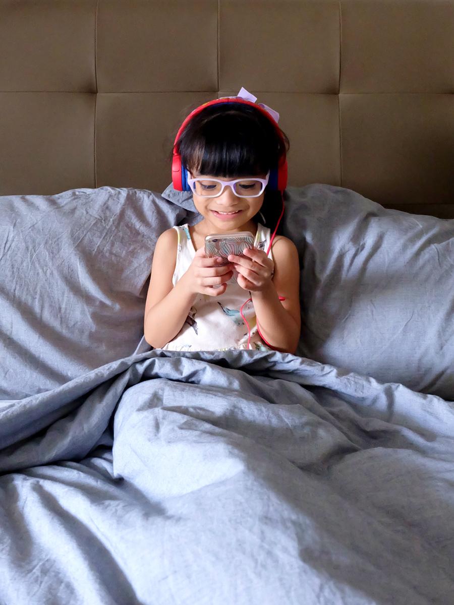 Zoë, enjoying her new JBL JR300 headphones in Spider Red